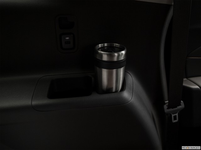 Third Row side cup holder with coffee prop.