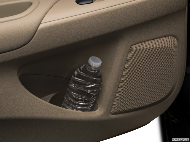 Second row side cup holder with coffee