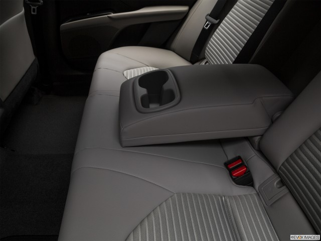 Rear center console with closed lid from drivers side looking down.